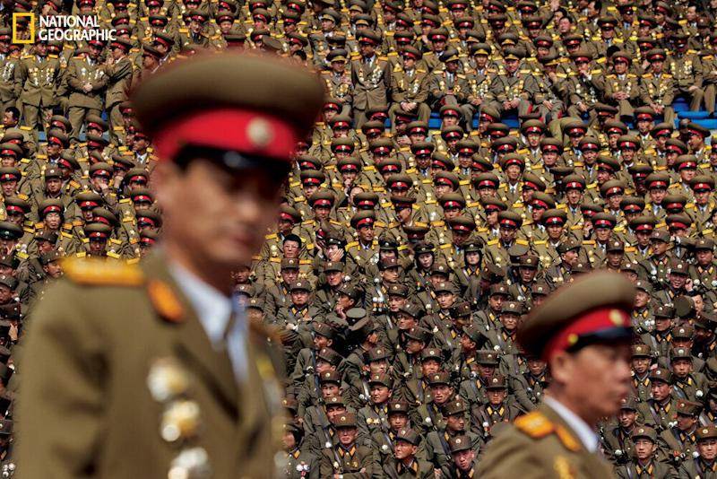Members of one of the world's largest militaries, over a million strong, pack a stadium in Pyongyang in 2012 during celebrations honoring North Korea's first leader, Kim Il Sung. (David Guttenfelder/National Geographic)