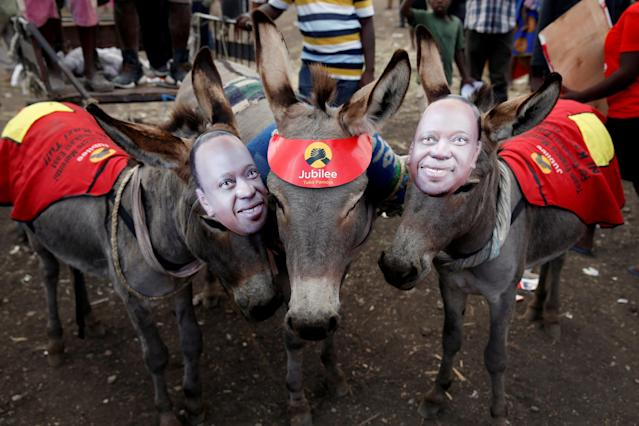 <p>Donkeys wearing masks depicting Kenya's President Uhuru Kenyatta stand during a Jubilee Party election rally in Nairobi, Kenya, July 21, 2017. (Photo: Baz Ratner/Reuters) </p>