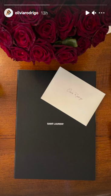 <p>Hours before the Met Gala the 'driver's license' singer shared a photo of a card with her name on it, red roses and a black Saint Laurent envelope. Jealous much? </p>