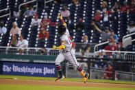 Atlanta Braves' Ronald Acuña Jr. runs the bases for his solo home run during the fifth inning of baseball game against the Washington Nationals at Nationals Park, Tuesday, May 4, 2021, in Washington. (AP Photo/Alex Brandon)