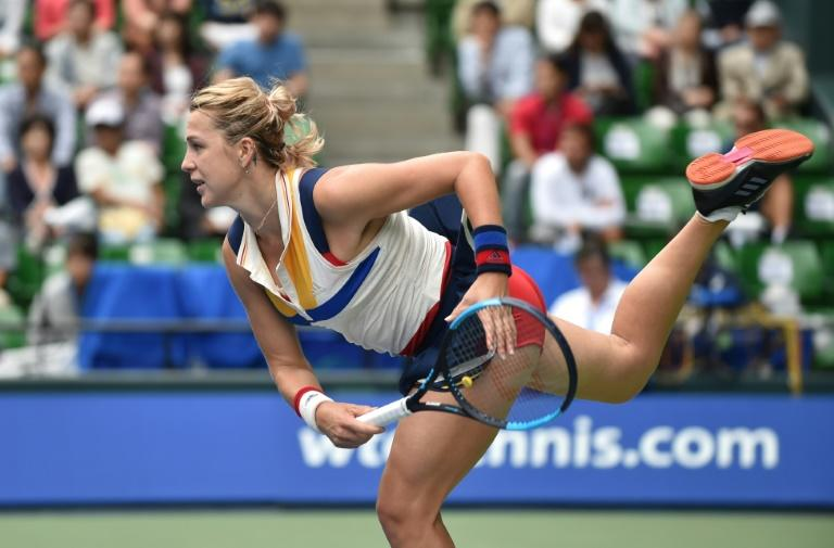 Anastasia Pavlyuchenkova of Russia serves against Angelique Kerber of Germany during their Pan Pacific Open semi-final match, in Tokyo, on September 23, 2017