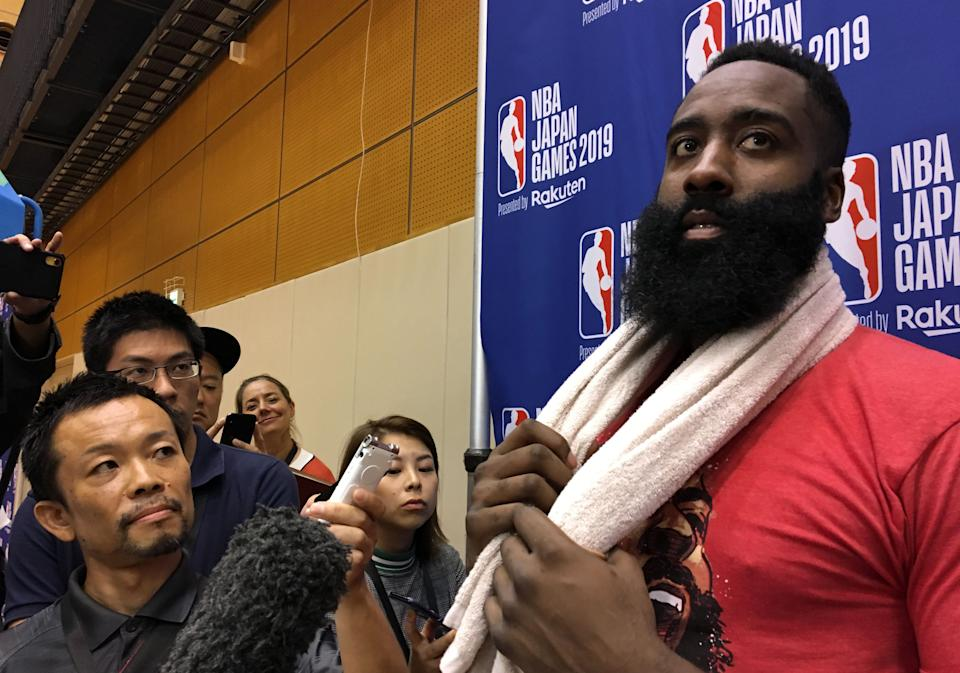 US player James Harden (R) of the National Basketball Association's (NBA) Houston Rockets speaks to the media after a training session in Tokyo on October 6, 2019, ahead of their exhibition games against NBA champions Toronto Raptors. (Photo by Natsuko FUKUE / AFP) (Photo by NATSUKO FUKUE/AFP via Getty Images)