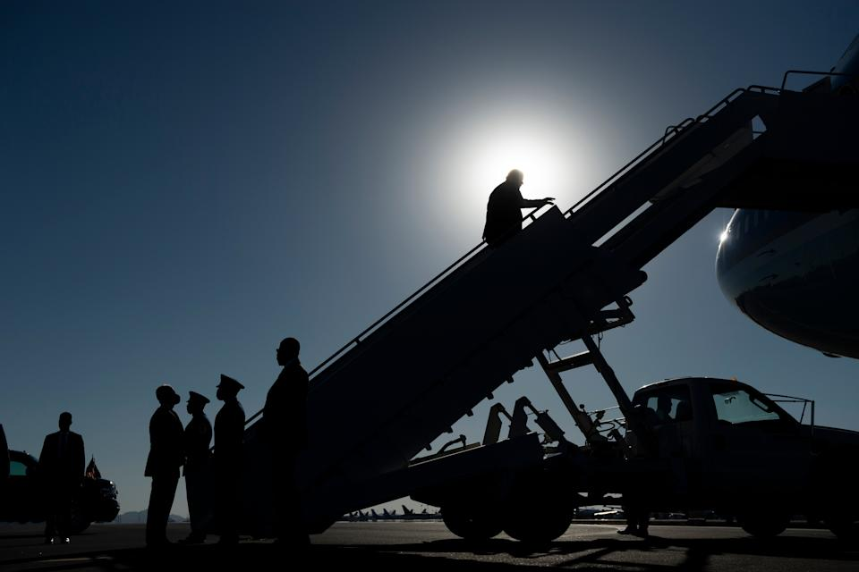 US President Donald Trump steps onto Air Force One as he leaves after speaking during a Make America Great Again rally at Phoenix Goodyear Airport October 28, 2020, in Goodyear, Arizona. (Photo by Brendan Smialowski / AFP) (Photo by BRENDAN SMIALOWSKI/AFP via Getty Images)