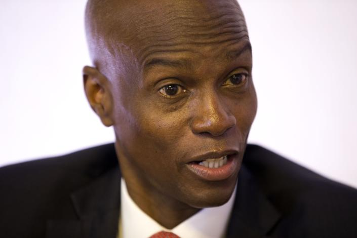 FILE - In this Aug. 28, 2019 file photo, Haiti's President Jovenel Moise speaks during an interview in his office in Port-au-Prince, Haiti. Moise is urging a pause in protests that have paralyzed the Caribbean nation. The Haitian leader appealed for calm and unity in a televised speech early Wednesday, Sept. 25, 2019, as he asked opponents to help his administration resolve the multiple problems Haiti is facing. (AP Photo/Dieu Nalio Chery, File)