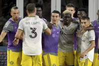 Columbus Crew forward Gyasi Zerdes (11), third from right, is congratulated by teammates after scoring during the second half of a MLS soccer match against the New England Revolution, Saturday, Sept. 18, 2021, in Foxborough, Mass. (AP Photo/Mary Schwalm)