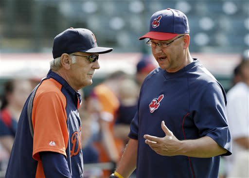 Cleveland Indians manager Terry Francona, right, talks with Detroit Tigers manager Jim Leyland before a baseball game on Friday, July 5, 2013, in Cleveland. (AP Photo/Mark Duncan)