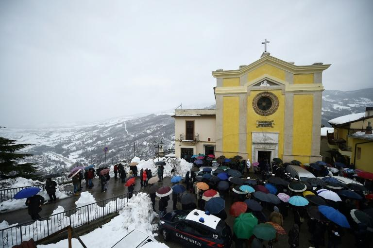 Mourners gather at a church in Farindola in Italy for the funeral on January 24, 2017, of Alessandro Giancaterino, one of the victims of the avalanche that hit hotel Rigopiano after an earthquake