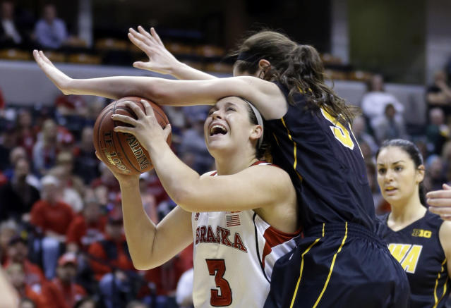 Iowa center Bethany Doolittle, right, fouls Nebraska forward Hailie Sample in the second half of an NCAA college basketball game in the finals of the Big Ten women's tournament in Indianapolis, Sunday, March 9, 2014. Nebraska defeated Iowa 72-65. (AP Photo/Michael Conroy)