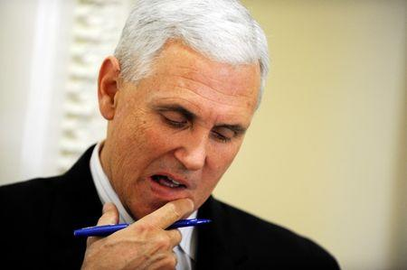 U.S. Representative Pence looks at his notes before a news conference at the U.S. Capitol in Washington
