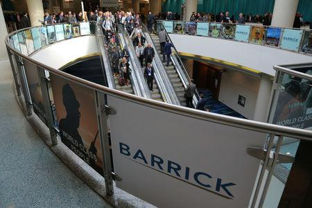 The logo of sponsor Barrick Gold Corporation is seen as visitors arrive during the PDAC convention in Toronto