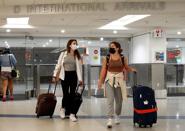 Travelers arrive at Miami International Airport on September 20, 2021.