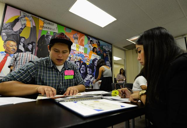 Pedro Leon Martinez receives help from volunteer Maria Peralta in filing his application for the Deferred Action for Childhood Arrivals program at the Coalition for Humane Immigrant Rights of Los Angeles on Aug. 15, 2012. (Photo: Kevork Djansezian/Getty Images)