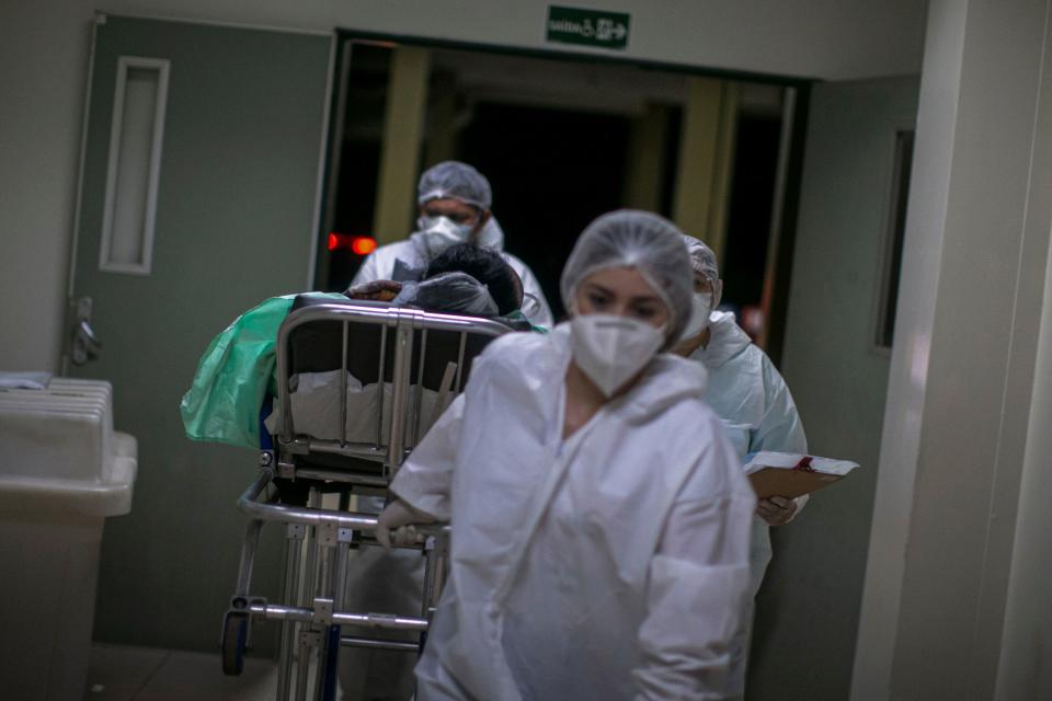 A coronavirus patient is taken to the ICU unit of the Regional Public Hospital of Baixo Amazonas in Santarem, Para state, Brazil, on January 30, 2021. - Para's State Governor Helder Barbalho ordered a lockdown on the region of Baixo Amazonas and Calha Norte of Para state to combate the spread of the coronavirus pandemic. (Photo by TARSO SARRAF / AFP) (Photo by TARSO SARRAF/AFP via Getty Images)