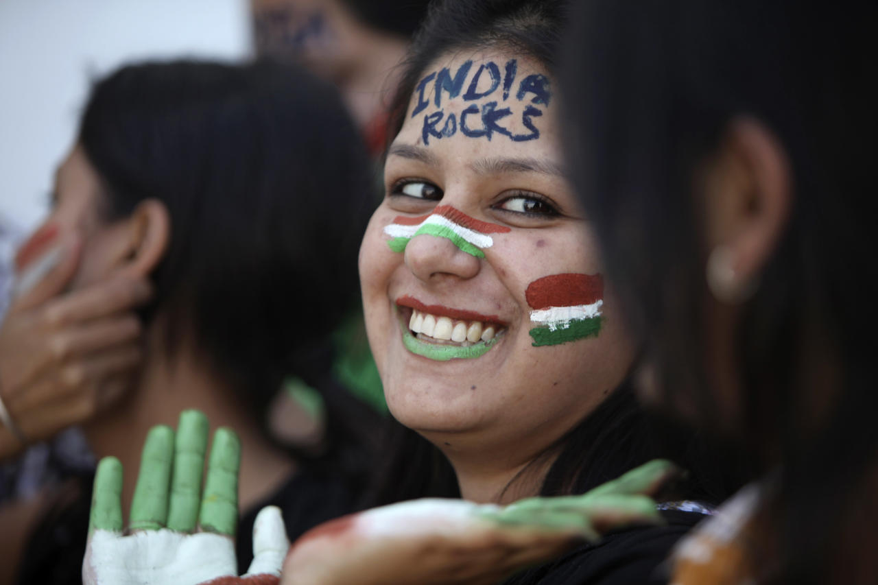 An Indian cricket fan, her face painted with the colors of the national flag, cheer for the team ahead of the ICC World Cup cricket final match between India and Sri Lanka, in Jammu, India, Friday, April 1, 2011.