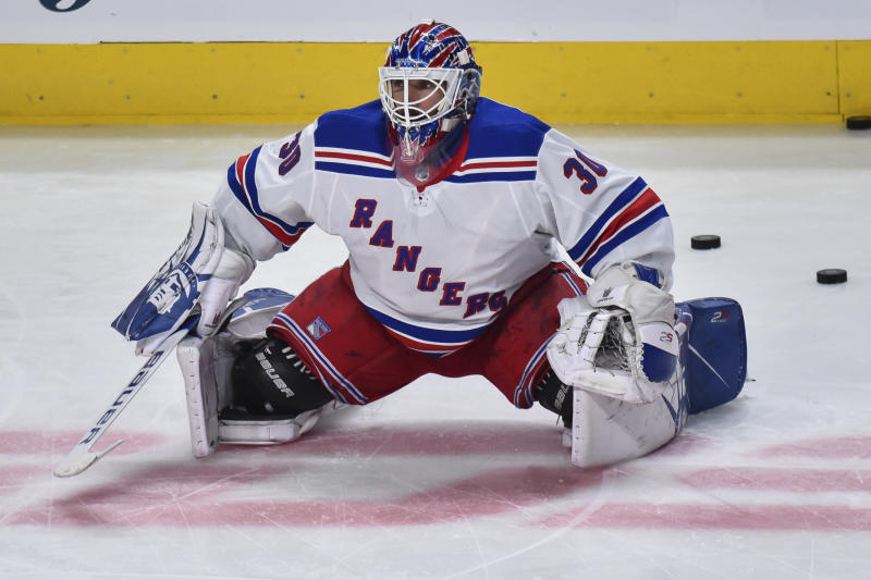 MONTREAL, QC - FEBRUARY 27: Goaltender Henrik Lundqvist #30 of the New York Rangers stretches during the warm-up prior to the game against the Montreal Canadiens at the Bell Centre on February 27, 2020 in Montreal, Canada. The New York Rangers defeated the Montreal Canadiens 5-2. (Photo by Minas Panagiotakis/Getty Images)