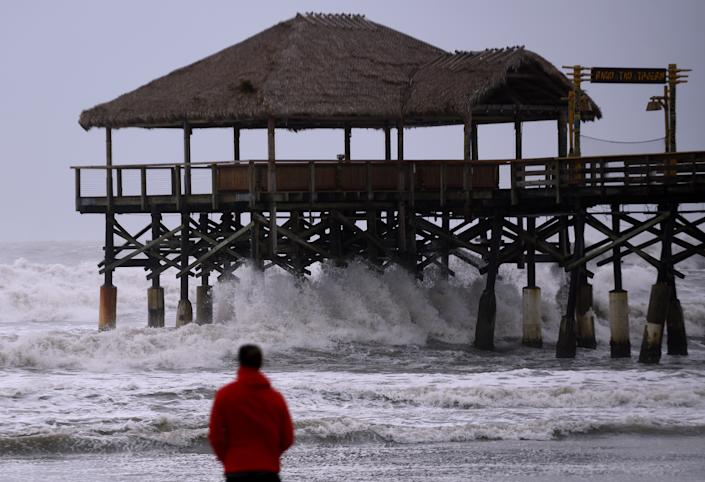 A man watches as strong waves crash into the Cocoa Beach Pier as Hurricane Dorian turns to the north off the eastern coast of Florida after a weakened Category 2 storm devastates parts of the Bahamas. (Photo: Paul Hennessy/SOPA Images/LightRocket via Getty Images)