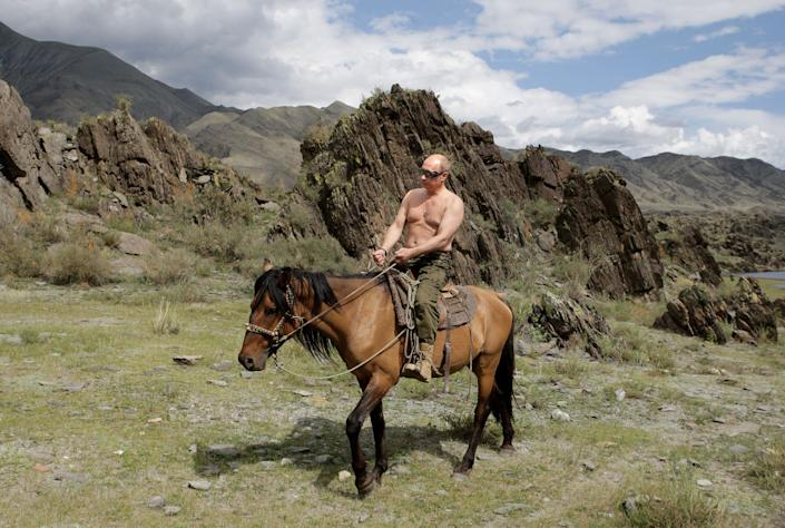 Putin goes horse riding topless in Southern Siberia, Russia, on Aug. 3, 2009.