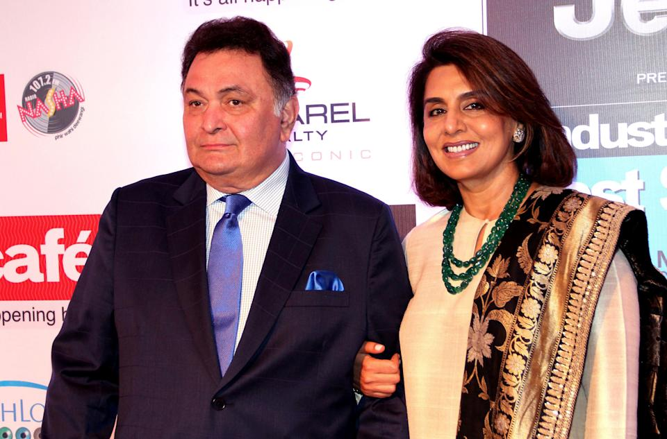 Indian Bollywood actor Rishi Kapoor (L) and actress Neetu Singh pose as they attend the