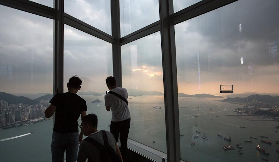 Visitors watch the sunset from Hong Kong's Sky 100, a 360-degree indoor observation deck at the International Commerce Centre, in West Kowloon. Photo: EPA-EFE