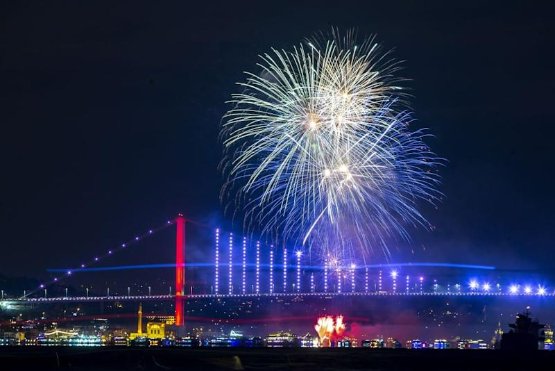 Fireworks go off in front of July 15 Martyrs' Bridge within the new year celebrations in Istanbul, Turkey on January 01, 2020. | Arif Hudaverdi Yaman—Anadolu Agency/Getty Images