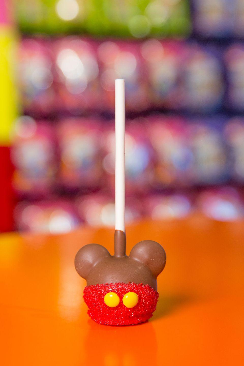"""<p>If you can dream it, Disney can most definitely turn it into a chocolate-coated caramel apple.</p><p>Get the recipe from <a href=""""https://www.delish.com/cooking/recipe-ideas/a36757991/disney-mickeys-caramel-apples/"""" rel=""""nofollow noopener"""" target=""""_blank"""" data-ylk=""""slk:Delish"""" class=""""link rapid-noclick-resp"""">Delish</a>.</p>"""