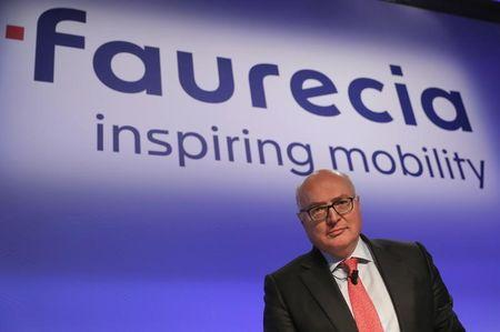 Patrick Koller, CEO of French car parts supplier Faurecia, poses before the company's 2016 annual results presentation in Paris