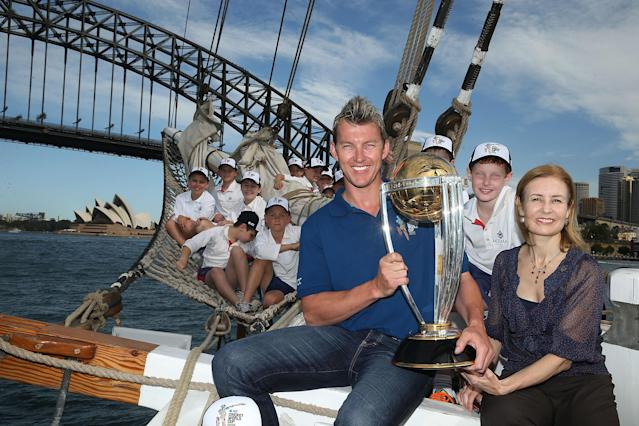 SYDNEY, AUSTRALIA - OCTOBER 02: Brett Lee and NSW Minister for Sport Gabrielle Upton pose on Sydney Harbour with the ICC Cricket World Cup trophy and junior cricketers from Mosman cricket club during celebrations to mark 500 days to go until the 2015 ICC Cricket World Cup on October 2, 2013 in Sydney, Australia. (Photo by Mark Metcalfe/Getty Images for the ICC)