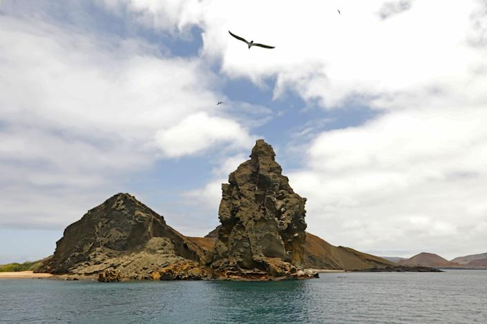 Pinnacle Rock is a celebrated volcanic plug on Bartholomew Island, one of Ecuador's Galapagos Islands.