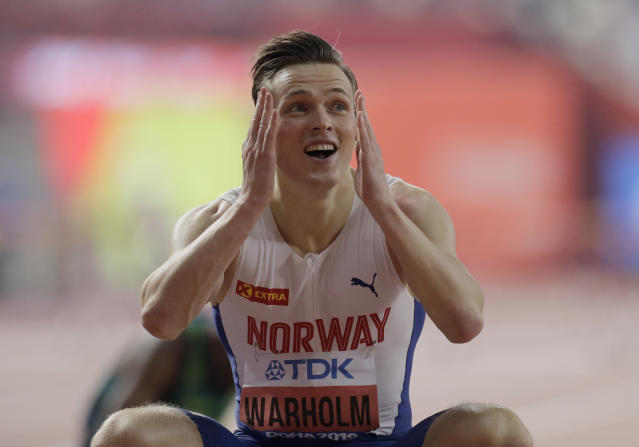 Karsten Warholm, of Norway wins the gold medal in the men's 400m hurdles final at the World Athletics Championships in Doha, Qatar, Monday, Sept. 30, 2019. (AP Photo/Petr David Josek)