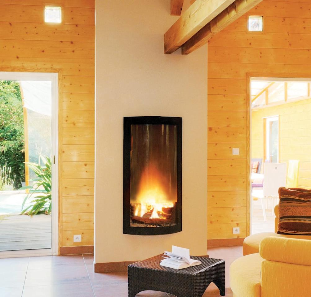 """<p>Don't think that the terms """"messy grate"""" and """"dirty hearth"""" are synonymous with rustic-style fireplaces. Modern designers have come a long way in mastering the art of combining effective heating with stylish aesthetics.</p><p>Case in point, this fabulous feature which combines the charm of a woodburner with the contemporary aesthetics of a modern fireplace design. Set into a dedicated chimney breast, this black metal box ensure a neat and ordered piece, but still manages to be the cosy heart of the home.</p>  Credits: homify / Diligence International Ltd"""