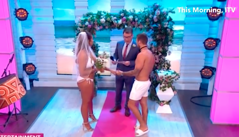 The pair wore nothing but white swimmers for the 'ceremony'. Photo: ITV