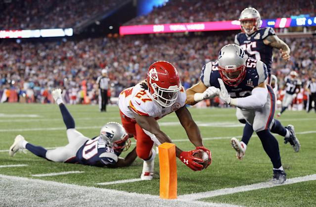 <p>Kareem Hunt #27 of the Kansas City Chiefs dives for the pylon to score a 4-yard rushing touchdown during the fourth quarter against the New England Patriots at Gillette Stadium on September 7, 2017 in Foxboro, Massachusetts. (Photo by Maddie Meyer/Getty Images) </p>