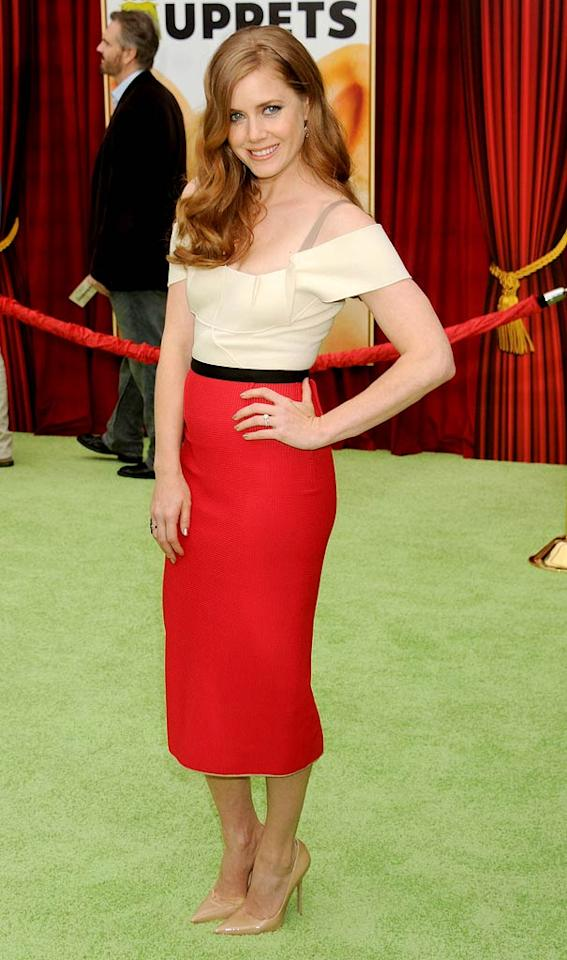 """And last but not least we have Amy Adams, who looked absolutely adorable at the highly anticipated premiere of """"The Muppets"""" in a tres chic Roland Mouret getup, which consisted of an alluring, off-the-shoulder top and sleek pencil skirt. (11/12/2011)"""