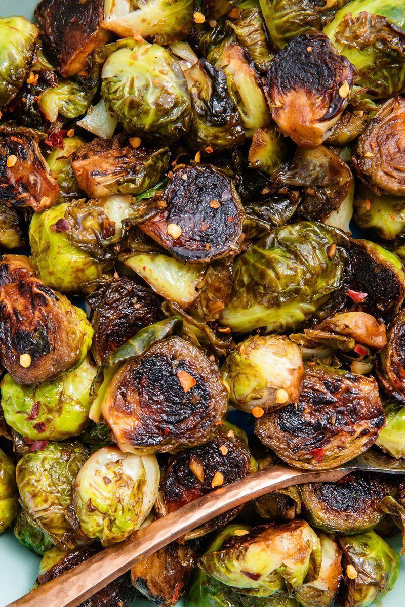 """<p>The hardest part of making these Brussels sprouts is leaving them alone. If you want that nice golden caramelisation, you gotta let those little guys cook undisturbed. You will be rewarded with sprouts that are both tender and crisp all at once. It's a game-changer! </p><p>Get the <a href=""""https://www.delish.com/uk/cooking/recipes/a28934268/honey-balsamic-glazed-brussels-sprouts-recipe/"""" rel=""""nofollow noopener"""" target=""""_blank"""" data-ylk=""""slk:Honey Balsamic Glazed Brussels Sprouts"""" class=""""link rapid-noclick-resp"""">Honey Balsamic Glazed Brussels Sprouts</a> recipe.</p>"""