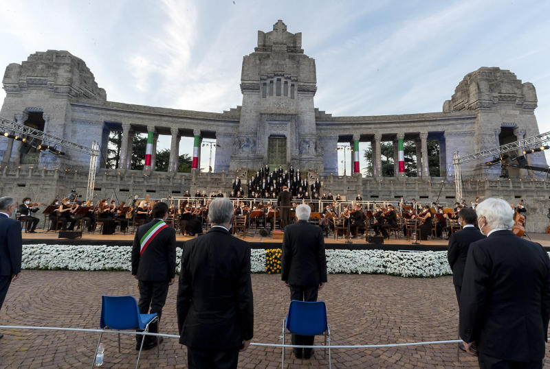 """Italian President Sergio Mattarella, center, speaks in front of Bergamo's cemetery, Sunday, June 28, 2020. Italy bid farewell to its coronavirus dead on Sunday with a haunting Requiem concert performed at the entrance to the cemetery of Bergamo, the hardest-hit province in the onetime epicenter of the outbreak in Europe. President Sergio Mattarella was the guest of honor, and said his presence made clear that all of Italy was bowing down to honor Bergamo's dead, """"the thousands of men and women killed by a sickness that is still greatly unknown and continues to threaten the world."""" (Italian Presidency via AP)"""