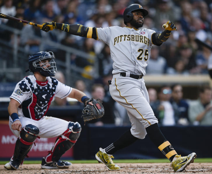 Pittsburgh Pirates' Gregory Polanco, right, looks up after hitting a solo home run during the fifth inning of a baseball game as San Diego Padres catcher Austin Hedges watches in San Diego, Saturday, May 18, 2019. (AP Photo/Kelvin Kuo)