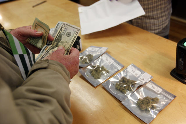 <p>A customer purchases marijuana at Harborside marijuana dispensary, Monday, Jan. 1, 2018, in Oakland, Calif. (Photo: Mathew Sumner/AP) </p>
