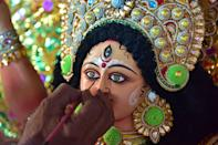 GUWAHATI, INDIA - OCTOBER 13, 2020: An artisan gives a final touches to an idol of the Goddess Durga ahead of the upcoming 'Durga Puja' festival in Guwahati ,India - PHOTOGRAPH BY Anuwar Ali Hazarika / Barcroft Studios / Future Publishing (Photo credit should read Anuwar Ali Hazarika/Barcroft Media via Getty Images)