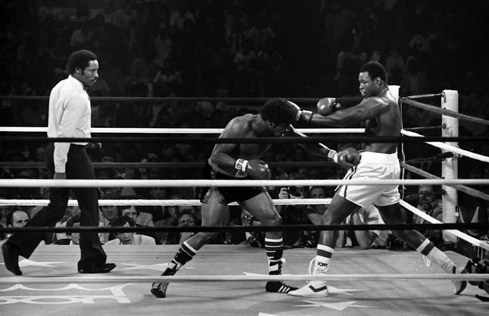 Larry Holmes (R) throws a left punch against Leon Spinks during the fight at the Joe Louis Arena on June 12,1981 in Detroit, Michigan. Larry Holmes won the WBC heavyweight title by a TKO 3.