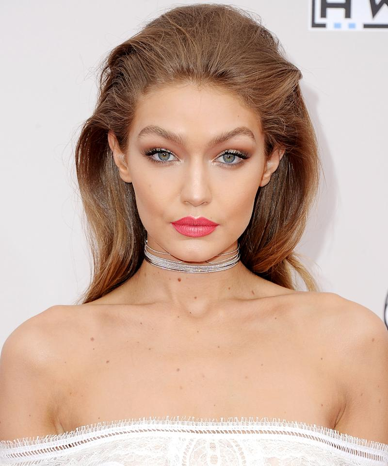"<p>Equal parts of Maybelline's All Fired Up and Nude Thrill lipsticks resulted in Hadid's coral pink lip.</p> <p>$6 each | <a rel=""nofollow"" href='http://click.linksynergy.com/fs-bin/click?id=93xLBvPhAeE&subid=0&offerid=462042.1&type=10&tmpid=19903&RD_PARM1=http%3A%2F%2Fwww.target.com%2Fp%2Fmaybelline-color-sensational-creamy-mattes-lip%2F-%2FA-16236788&u1=ISMM'>SHOP IT</a></p>"