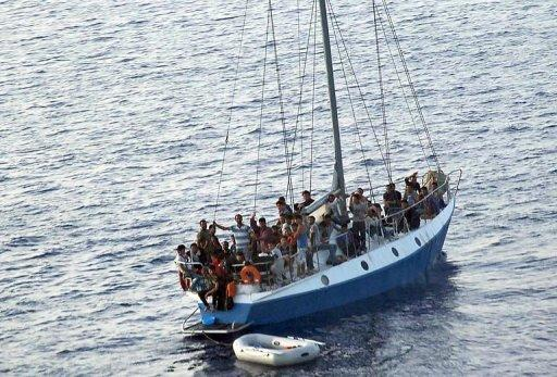 A ship carrying 65 illegal immigrants heads towards Italy on July 2