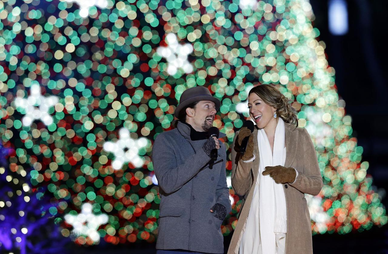 Jason Mraz, left, and Colbie Caillat, sing during the 90th annual National Christmas Tree Lighting ceremony on the Ellipse south of the White House, Thursday, Dec. 6, 2012 in Washington. (AP Photo/Alex Brandon)