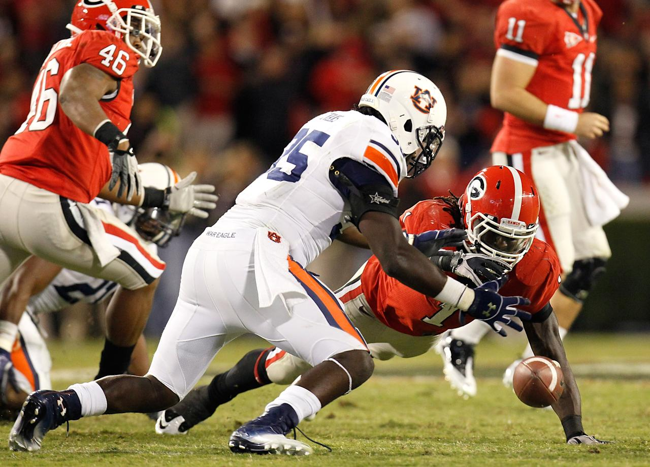 ATHENS, GA - NOVEMBER 12:  Isaiah Crowell #1 of the Georgia Bulldogs fumbles the ball as he rushes toward Jonathan Evans #35 of the Auburn Tigers at Sanford Stadium on November 12, 2011 in Athens, Georgia.  (Photo by Kevin C. Cox/Getty Images)