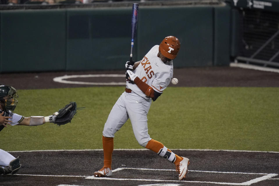Texas' Trey Faltine is hit with a pitch by South Florida's Orion Kerkering during the fourth inning of an NCAA Super Regional college baseball game, Sunday, June 13, 2021, in Austin, Texas. (AP Photo/Eric Gay)