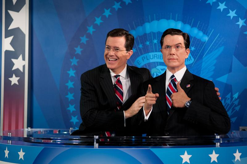 In this photo provided by Madame Tussauds wax museum, Stephen Colbert reacts to seeing his wax figure for the first time at Madame Tussauds in Washington, Friday, Nov. 16, 2012. Colbert helped unveil his wax likeness in the attraction's Media Room, which was renovated to include a replica set of The Colbert Report.  (AP Photo/Madame Tussauds, Trevor Pound) MANDATORY CREDIT