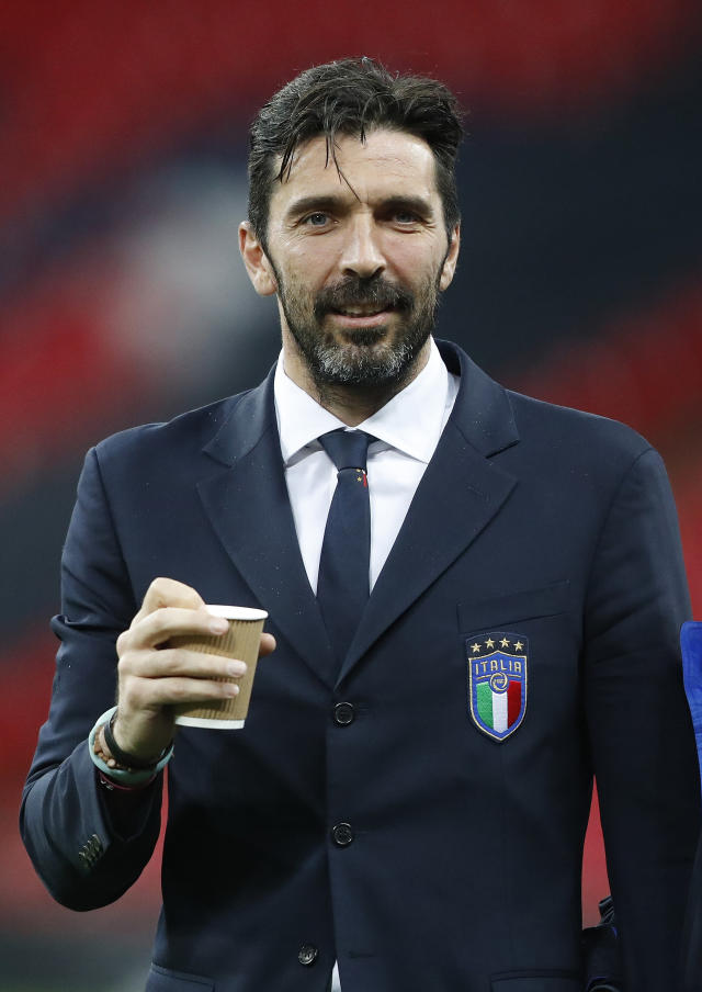FILE - In this March 26, 2018 file photo Italy's goalkeeper Gianluigi Buffon holds a cup during a walkaround at Wembley Stadium, a day ahead of the international friendly soccer match between England and Italy in London. Buffon on Friday, July 6, 2018 has signed for Paris Saint-Germain as a free agent, penning a one-year deal with the option for an additional season. (AP Photo/Frank Augstein, file)
