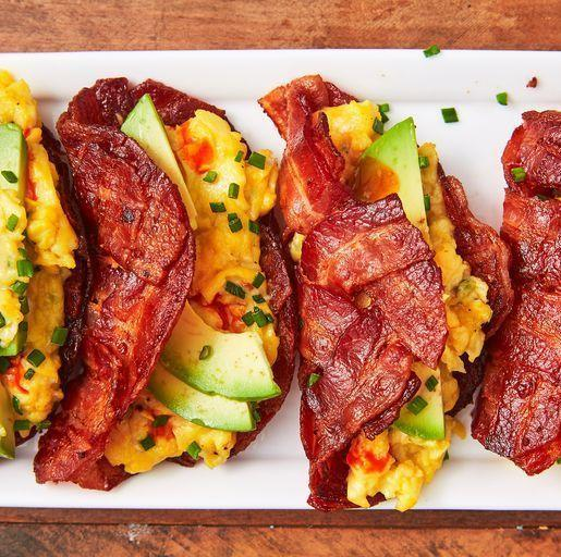 """<p>Nothing kickstarts your day like a high protein, low carb breakfast! We looove whipping up our <a href=""""https://www.delish.com/uk/cooking/recipes/a34939790/bacon-weave-breakfast-sandwich-recipe/"""" rel=""""nofollow noopener"""" target=""""_blank"""" data-ylk=""""slk:Bacon Weave Breakfast Sandwiches"""" class=""""link rapid-noclick-resp"""">Bacon Weave Breakfast Sandwiches</a> for a high-energy day, and this taco variation mixes it up in the best way possible.</p><p>Get the <a href=""""https://www.delish.com/uk/cooking/recipes/a34939698/bacon-weave-breakfast-tacos/"""" rel=""""nofollow noopener"""" target=""""_blank"""" data-ylk=""""slk:Bacon Weave Breakfast Tacos"""" class=""""link rapid-noclick-resp"""">Bacon Weave Breakfast Tacos</a> recipe.</p>"""