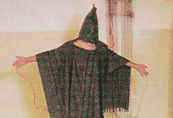 A hooded and wired Iraqi prisoner is seen at the Abu Ghraib prison near Baghdad (AP)
