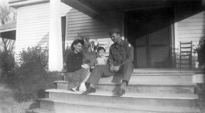"In this image provided by the McConnell Center at the University of Louisville, Mitch McConnell sits with his parents, Julia ""Dean"" and A.M. McConnell in this image from the mid 1940's in Five Points, Ala. As the coronavirus pandemic unfolds, Senate Majority Leader Mitch McConnell flashes back to an earlier crisis that gripped the nation, and his own life, when he was a boy. He was struck with polio."