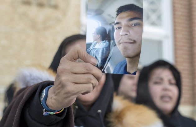 Colten Boushie's mother Debbie Baptiste holds up a picture of her son as she leaves the Court of Queen's Bench during the trial of Gerald Stanley, the farmer accused of killing the 22-year-old man, in Battleford Sask. on Feb. 5, 2018.